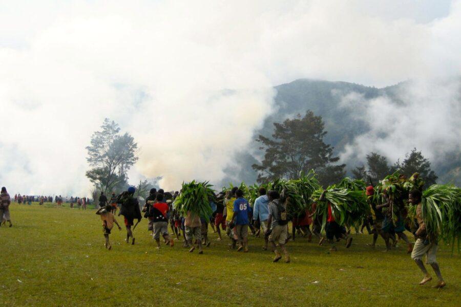 Tribal groups run down the field