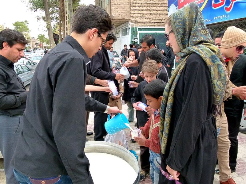 Dariece receiving a free drink on the streets of Kerman during Ashura.