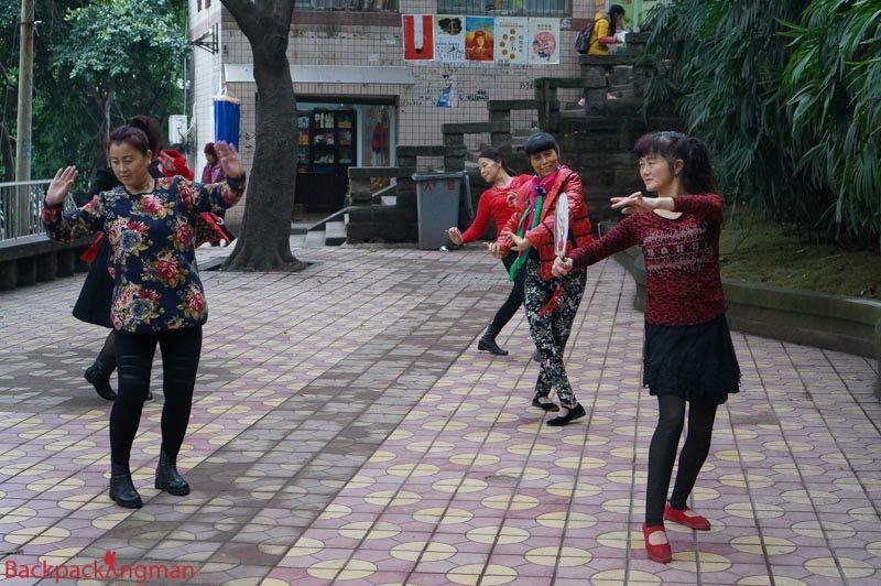 Women dance in Chongqing.