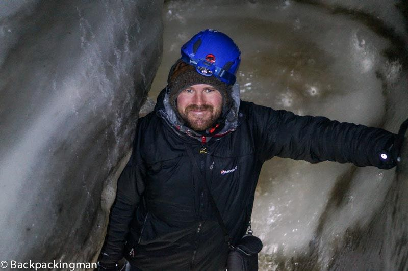 Exploing the ice cave in Svalbard