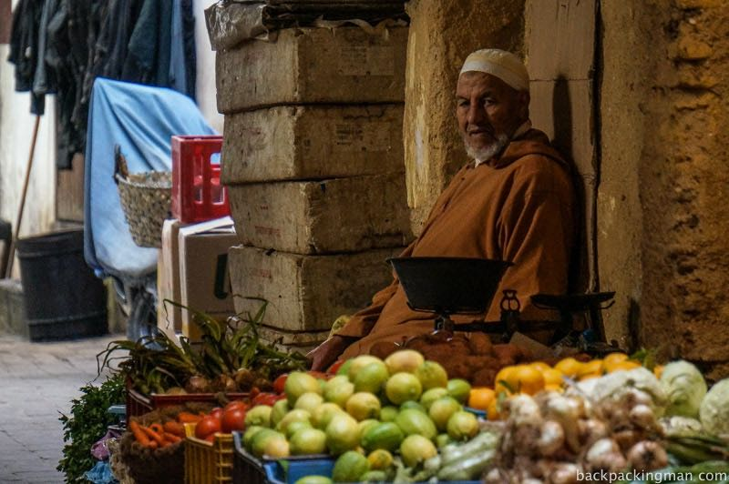 Man selling fruit inside Fes medina.