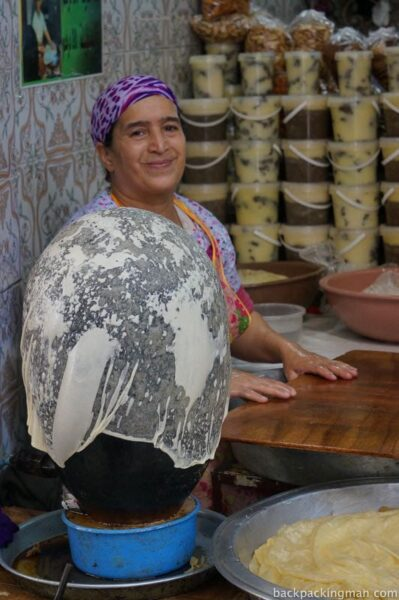 Woman makes sweets in Fes medina