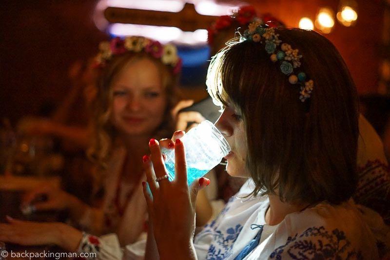 Best bars in Kiev - drinks at Banka bar wearing traditional Ukrainian clothes.