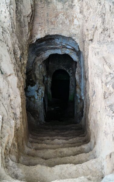 Entering a tomb.