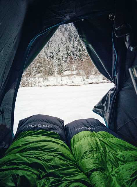 sleeping bags inside a tent - camping essentials