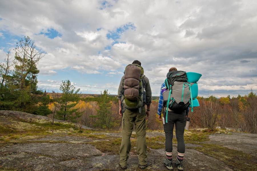 2 people backpacking in nature