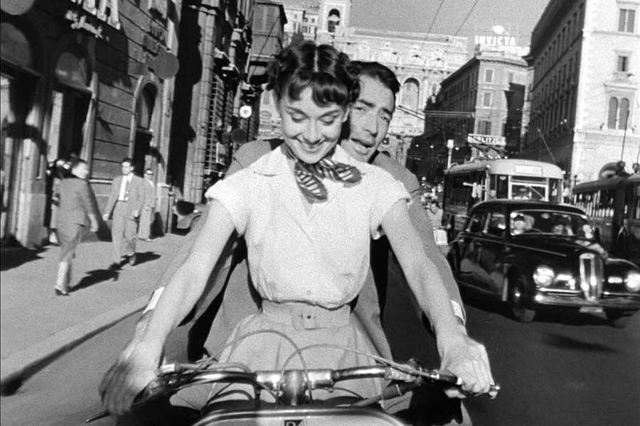 Italy 2 people riding on Vespa