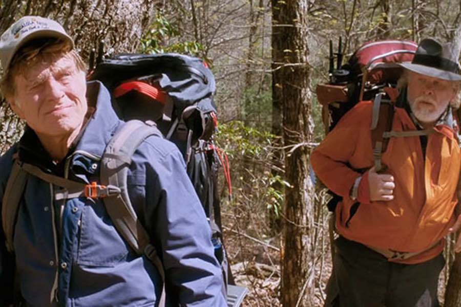 old men backpacking in woods