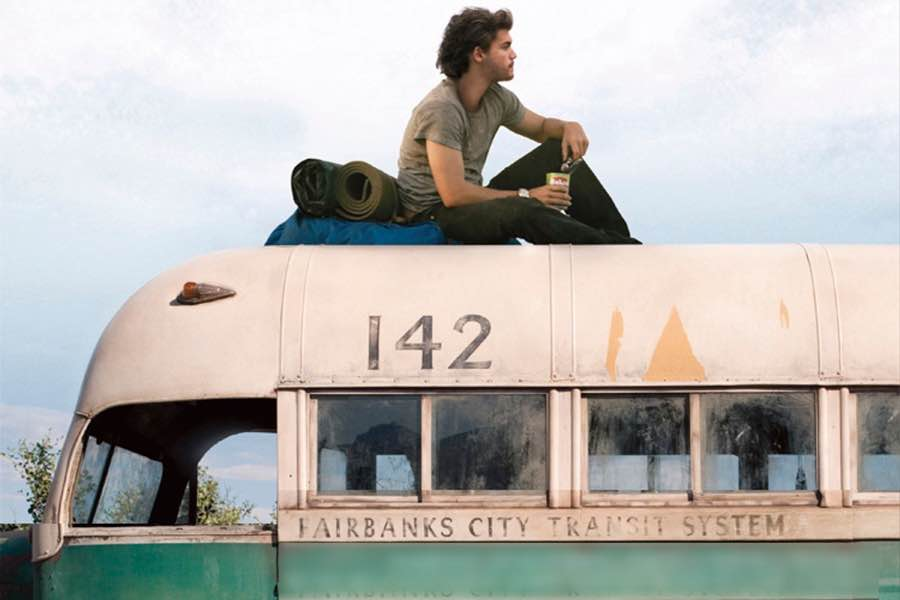 backpacking movies - into the wild man sitting on top of a bus