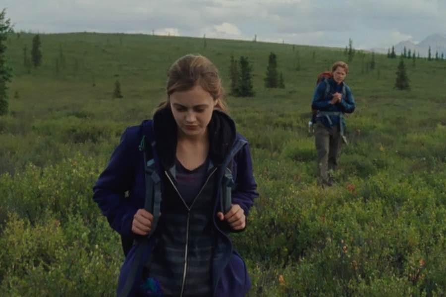 girl and men hiking in wilderness